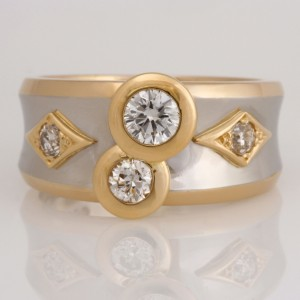 Handmade ladies 18ct yellow gold and palladium ring featuring brilliant cut diamonds