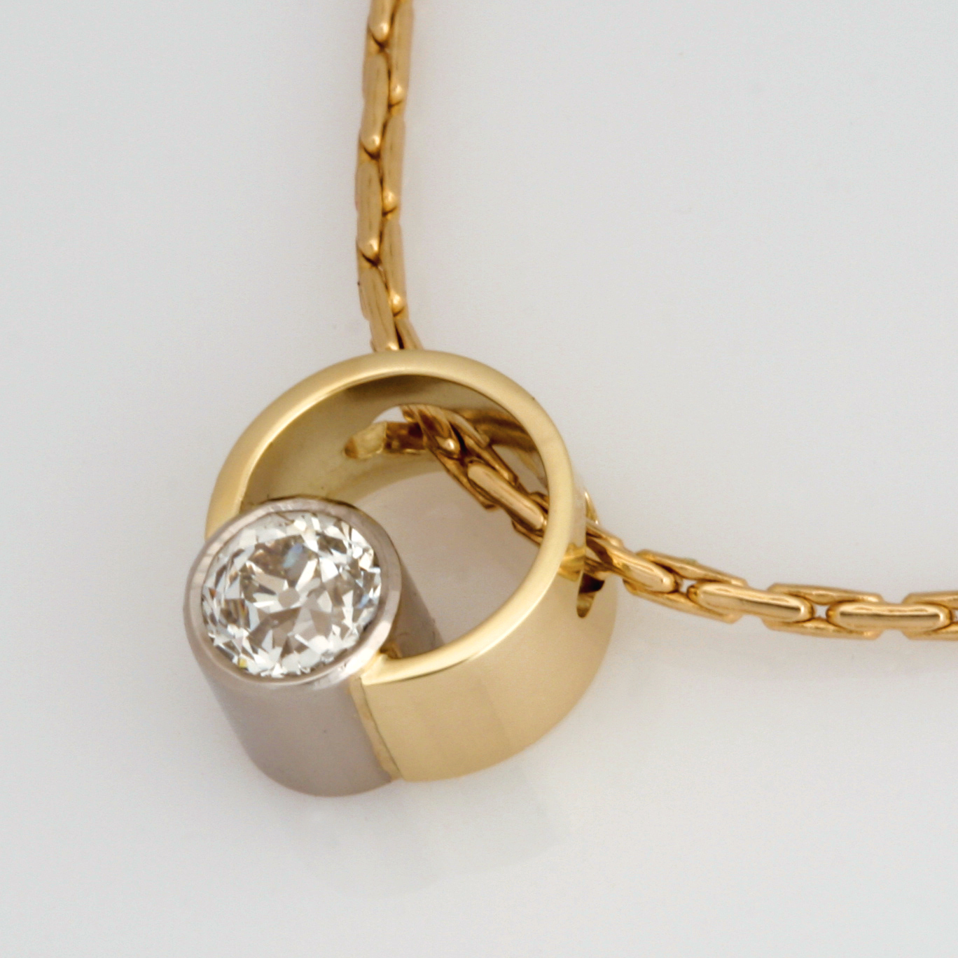 Handmade ladies 18ct yellow gold and palladium old cut diamond pendant featured on a 14ct yellow gold chain.