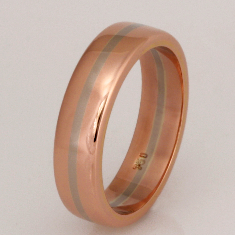 Handmade ladies 18ct rose gold wedding ring featuring an 18ct white gold centre stripe