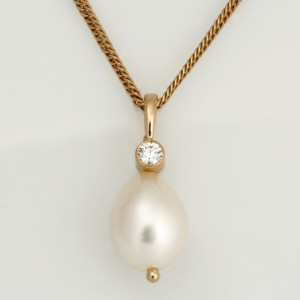 Handmade ladies fresh water oval pearl and diamond pendant in 18ct yellow gold with a 22ct yellow gold bezel