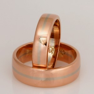 Handmade Gents and Ladies 18ct rose gold matching wedding rings featuring an 18ct white gold stripe
