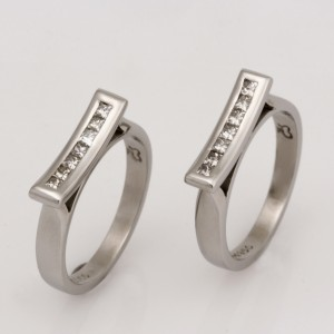Handmade ladies palladium split wedding rings featuring princess cut diamonds.