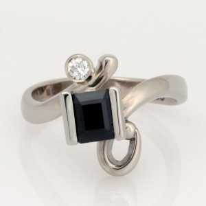 Handmade ladies 18ct white gold ring featuring a sapphire and brilliant cut diamond.