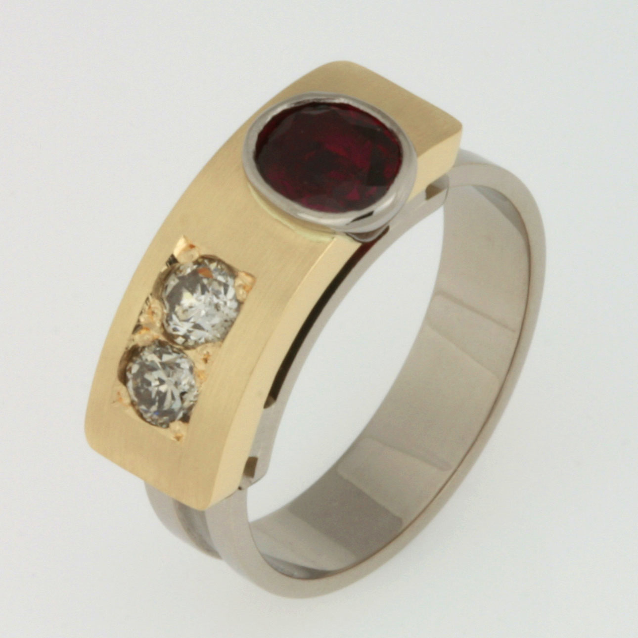 "Handmade ladies 18ct yellow gold and 18ct white gold 'Archie"" style ring featuring diamonds and an oval ruby"