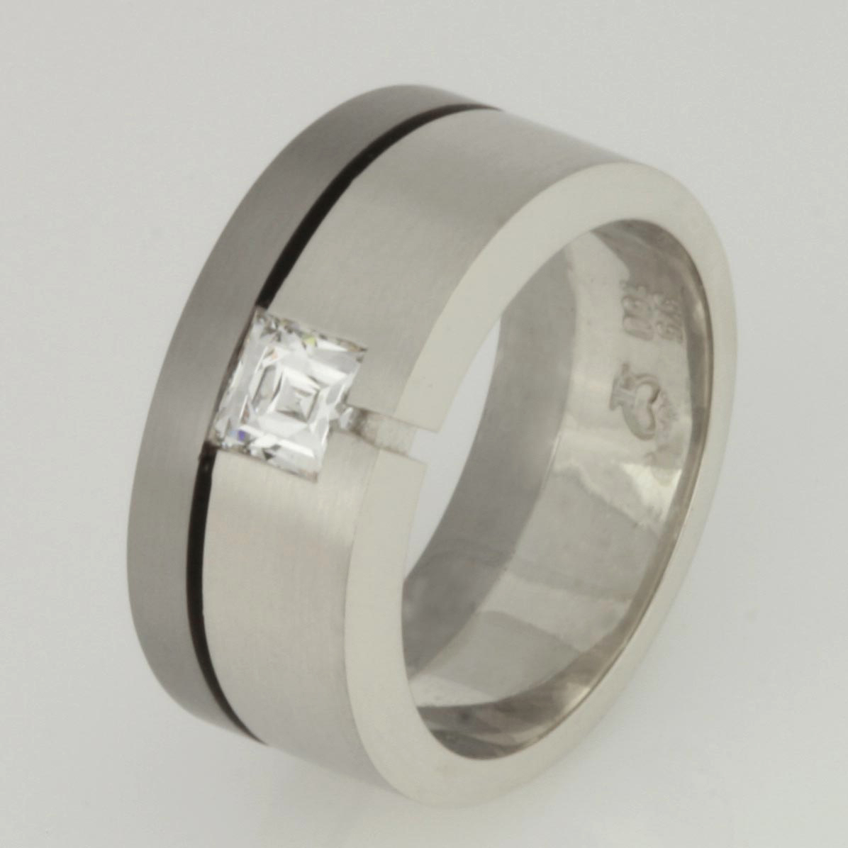 Handmade 18ct and 9ct white gold wedding ring featuring a Tycoon cut diamond