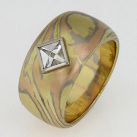 Handmade 18ct green, white and rose gold Mokume Gane ring featuring a Context cut diamond