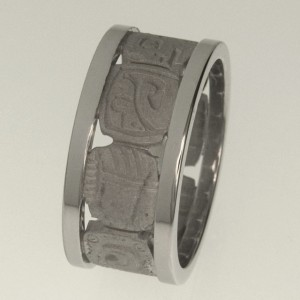Handmade gents ring featuring sandblasted shaped tablets with 8 different engraved gylph between two platinum bands