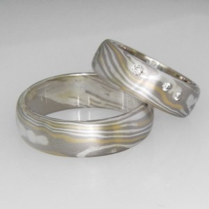 Handmade Ladies and Gents 9ct white gold, sterling silver and 18ct yellow gold Mokume Gane wedding bands featuring white diamonds.