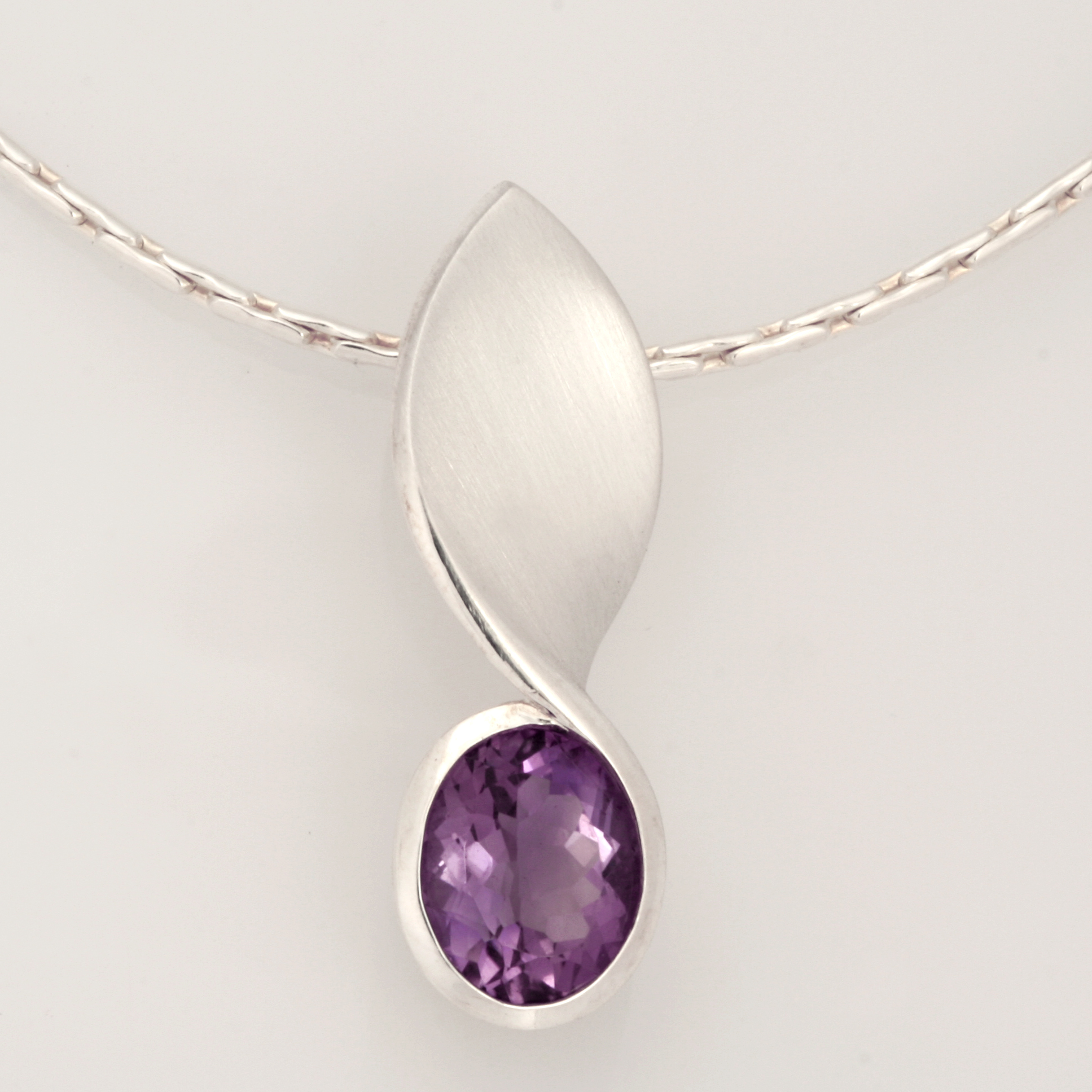 P097  Sterling silver pendant featuring an oval amethyst. $260 pendant only
