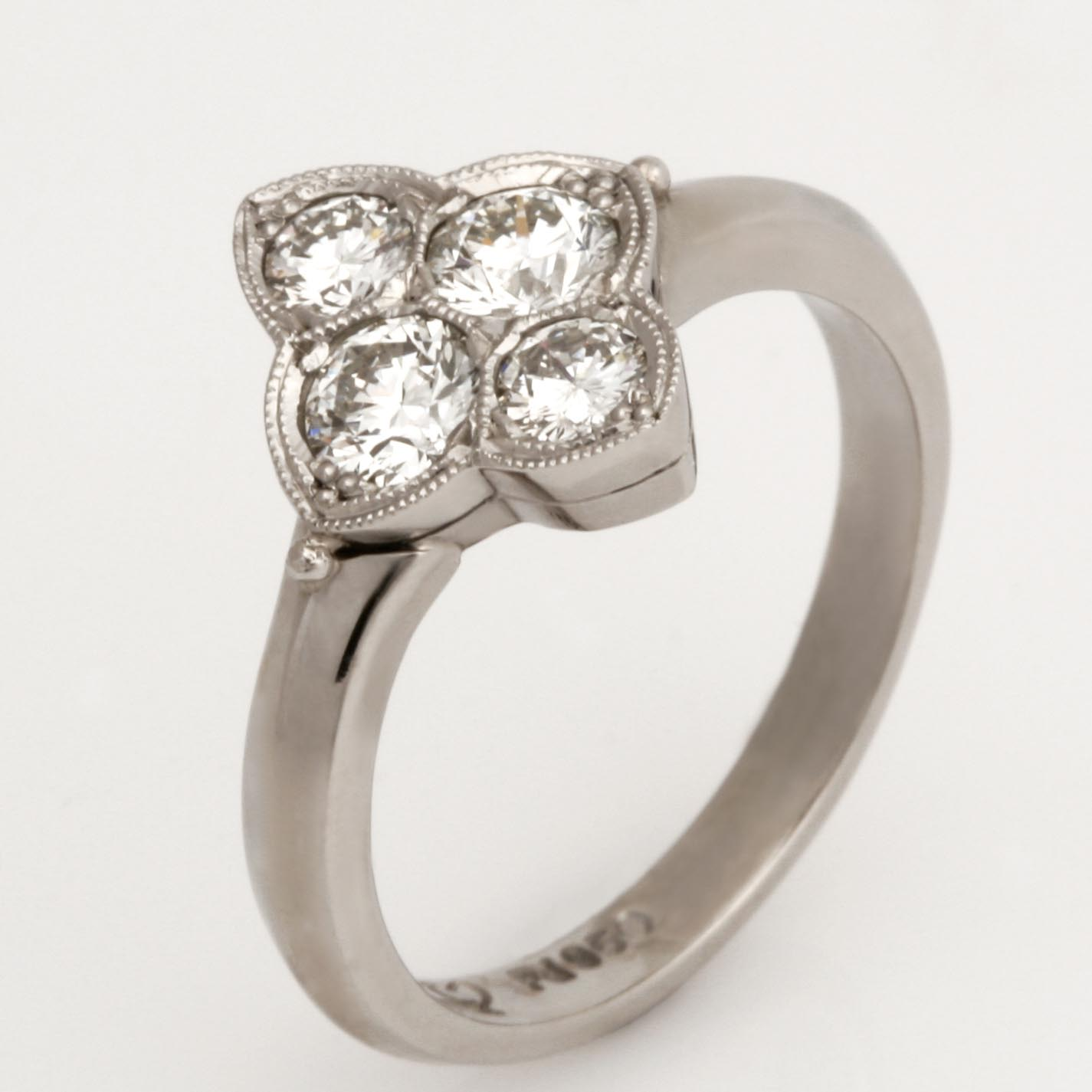 Handmade ladies palladium brilliant cut diamond ring featuring a millgrain edging.