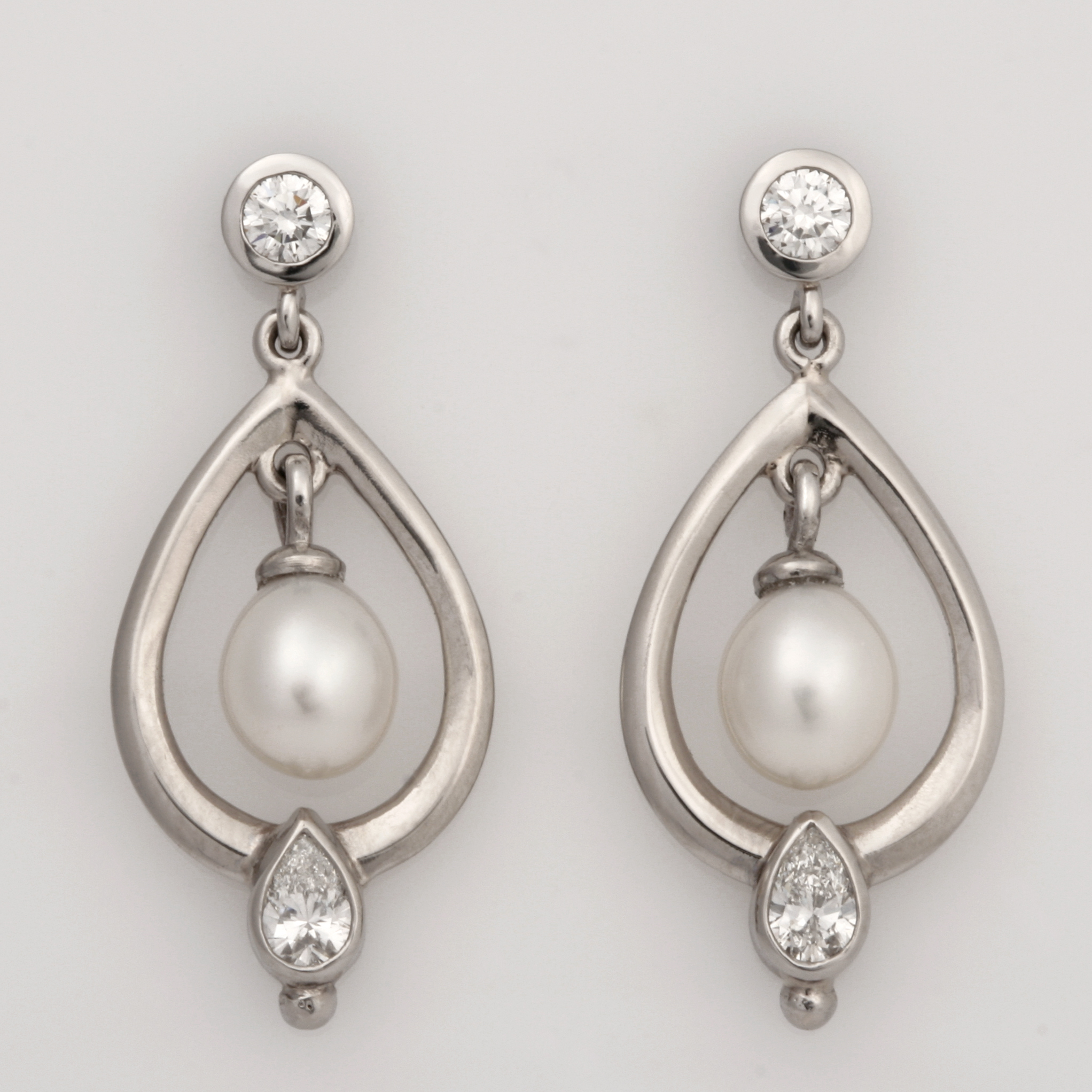 Handmade ladies palladium and 18ct white gold pearl and diamond drop earrings.