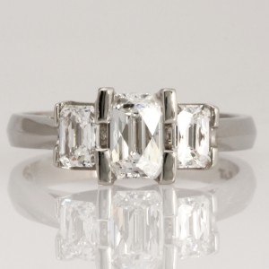 Handmade ladies platinum engagement ring featuring 3 Tycoon 8 cut diamonds.
