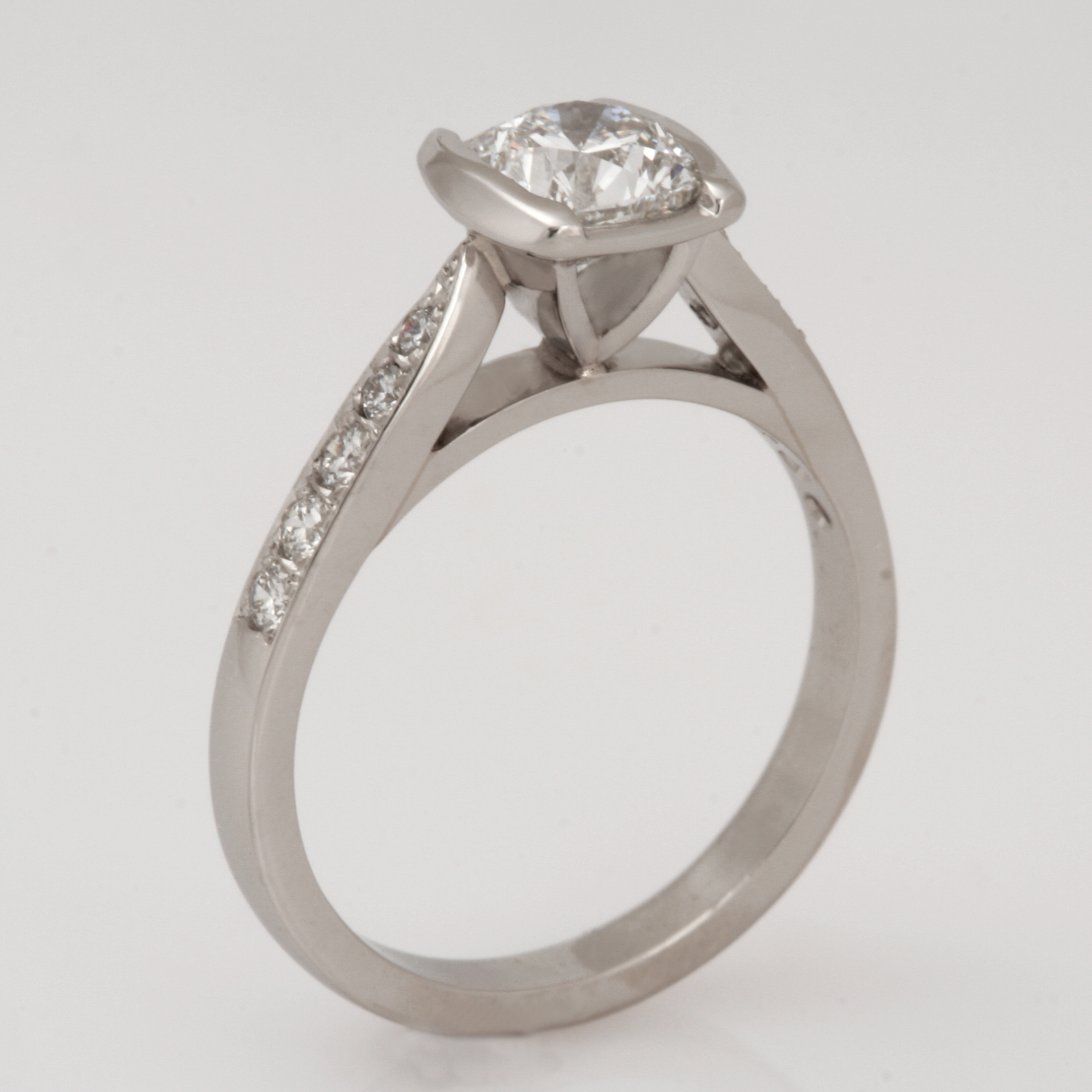 Handmade ladies platinum square cushion cut diamond engagement ring.