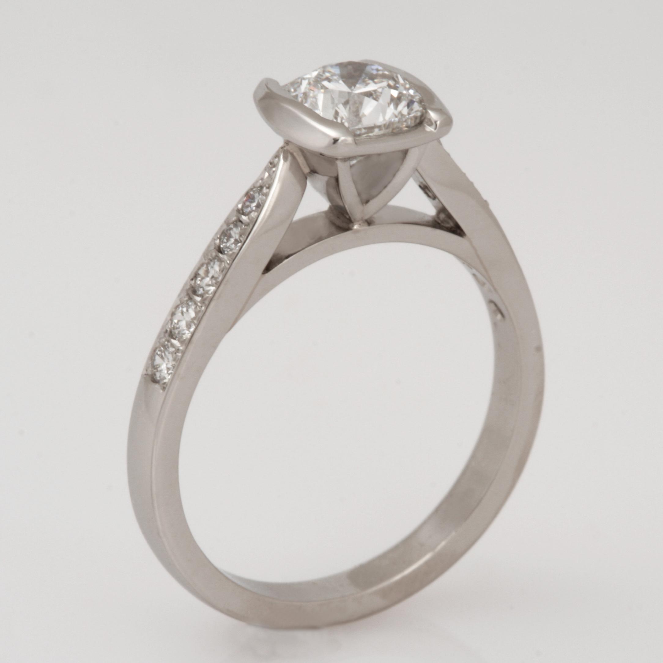 Handmade ladies platinum square cushion cut diamond engagement ring.