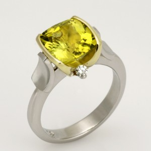 Handmade ladies platinum and 18ct green gold ring with an asymmetrical setting featuring a cushion cut yellow green tourmaline and diamonds