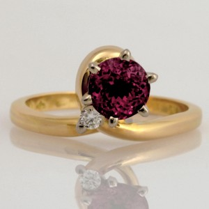 Handmade ladies 18ct yellow gold ring featuring a round purplish pink Malay garnet and diamond