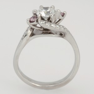 Handmade ladies platinum diamond engagement ring featuring pink and white diamonds.