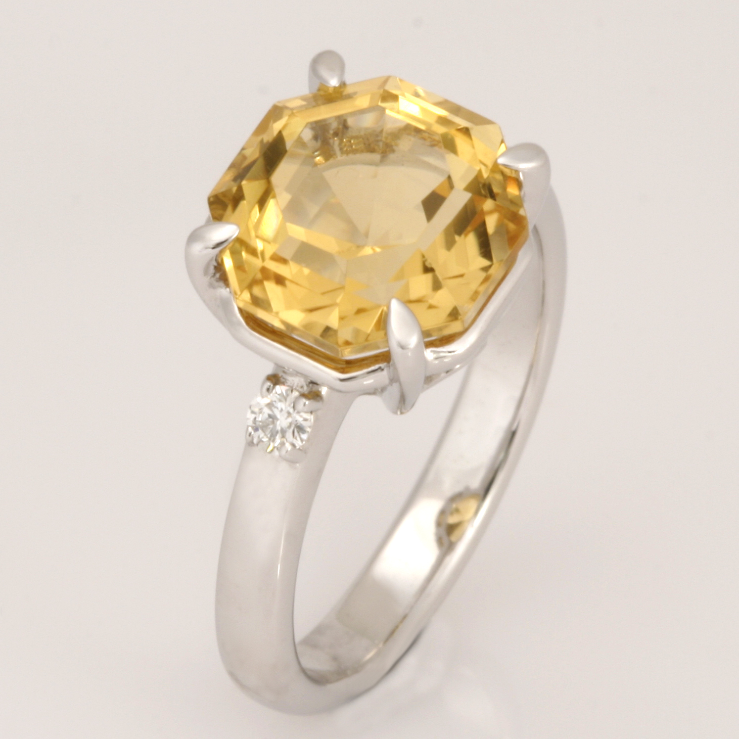 R155 9ct white gold 10mm octagonal citrine ring with 2 x 0.05ctea diamonds on the shoulders $850