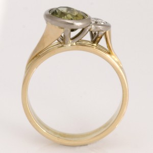Handmade ladies 18ct yellow gold ring featuring a greenish yellow oval parti sapphire and diamond.