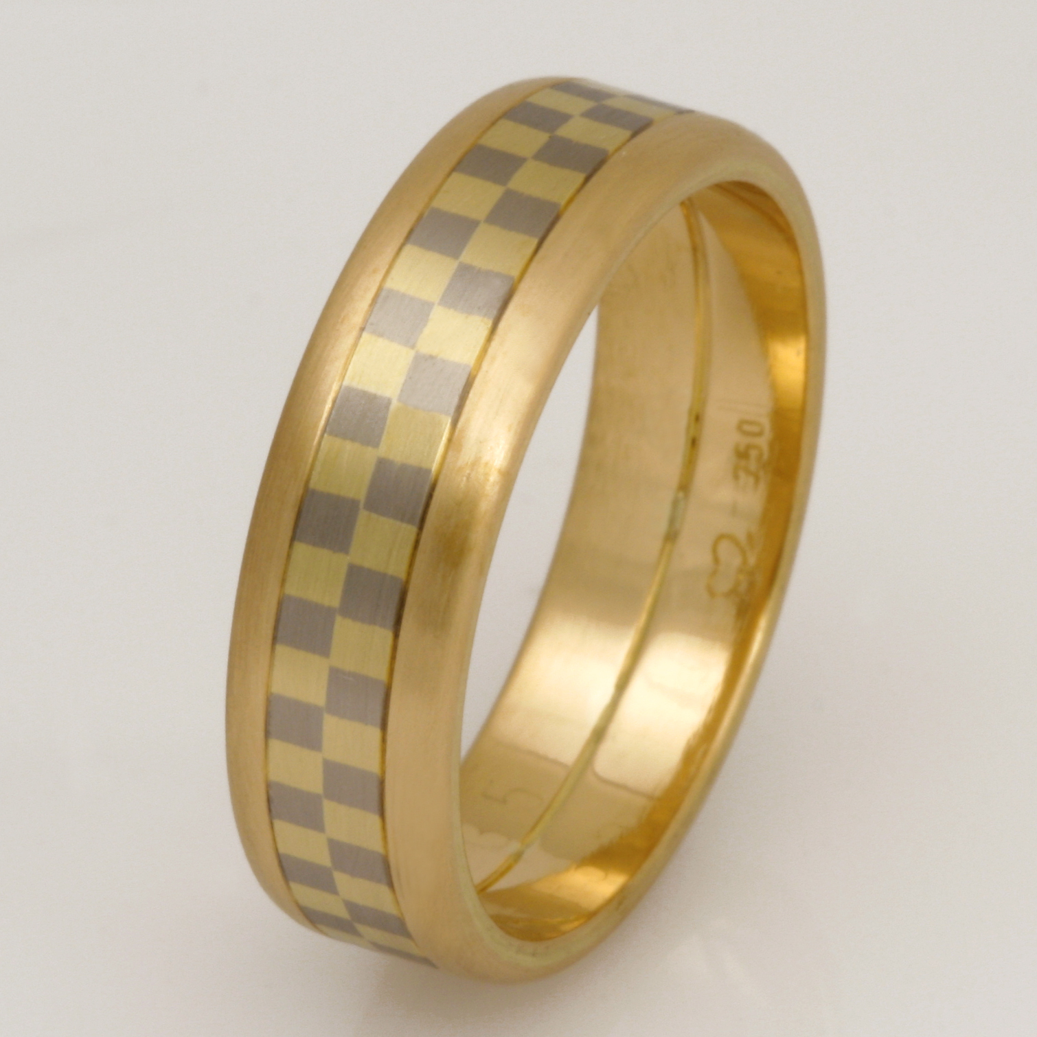 Handmade gents 18ct yellow ring featuring an 18ct yellow and white gold checkered middle inlay.