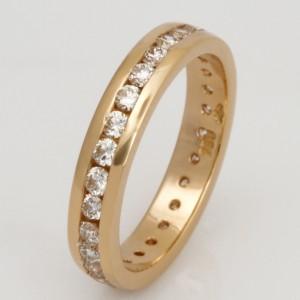 Handmade ladies 18ct yellow gold ring featuring diamonds surrounding the band