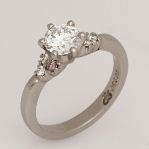 Handmade ladies Palladium diamond engagement ring featuring white diamonds and two round pink diamonds