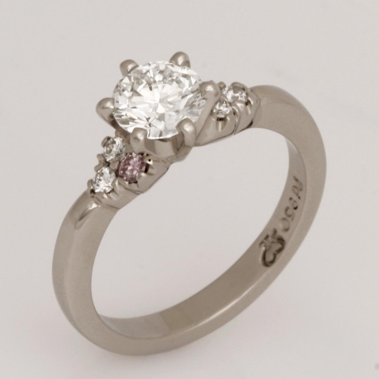 Handmade ladies Palladium diamond engagement ring featuring white diamonds and two round pink diamonds