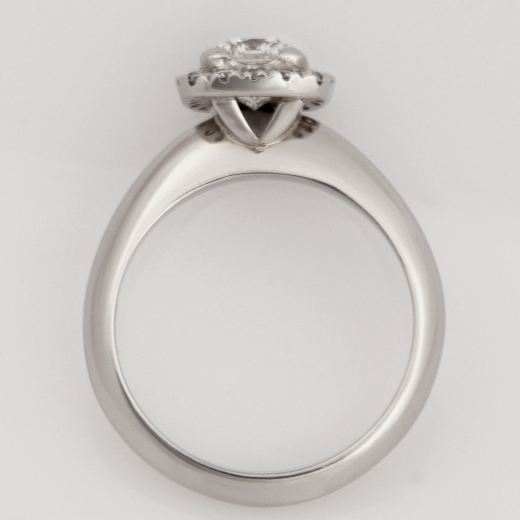 Handmade ladies Platinum engagement ring featuring a cushion cut diamond surrounded by a halo of round diamonds.