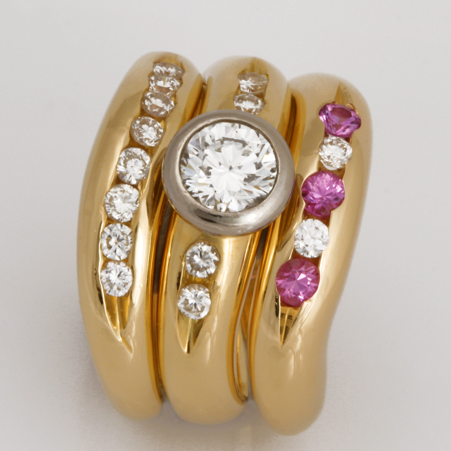 Handmade ladies 18ct yellow gold Eternity ring featuring pink sapphires and diamonds.