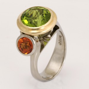 "R139 – Palladium and 14ct yellow gold flower 2 ring featuring 1 x 10mm round peridot 4.49cts and 1 x spessartite garnet 1.22cts Finger size ""M"" $3506"