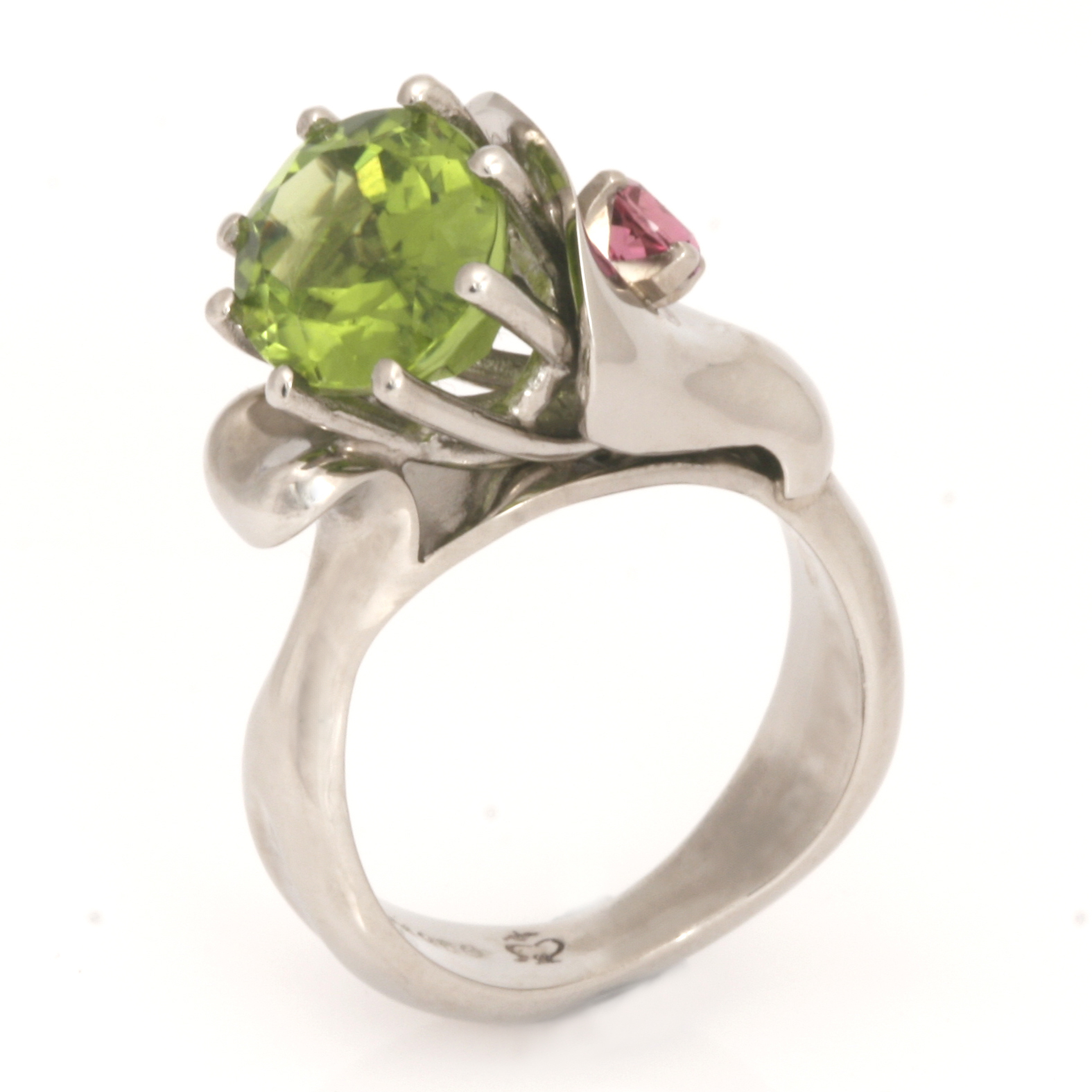 "R150 – palladium bonsai ring with 4.35ct oval peridot and 4mm round pink tourmaline set in a 9ct white gold setting 10.11 grams finger size ""M"" $2840"
