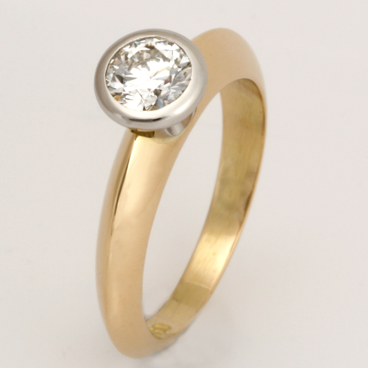 Handmade ladies 18ct yellow gold and platinum diamond engagement ring.