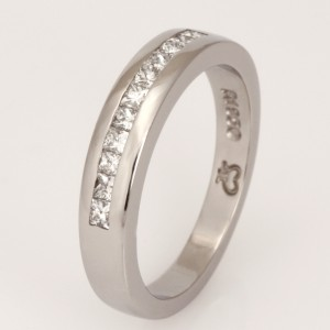 Handmade ladies palladium wedding ring featuring princess cut diamonds