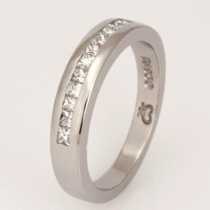 Handmade ladies palladium wedding ring featuring princess cut diamonds