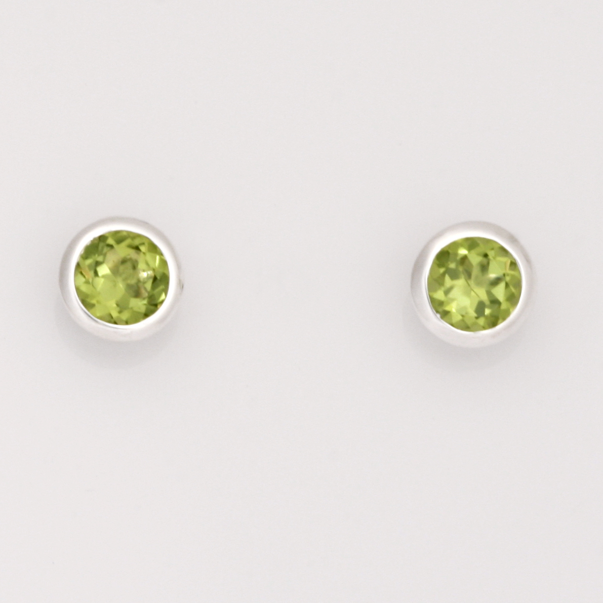 E0212 Sterling silver bezel set round peridot stud earrings $185