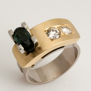 Handmade ladies 18ct yellow and white gold Archie style ring featuring a blue/green sapphire and diamonds.