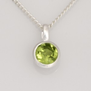 P115 Sterling silver bezel set round peridot pendant only $245