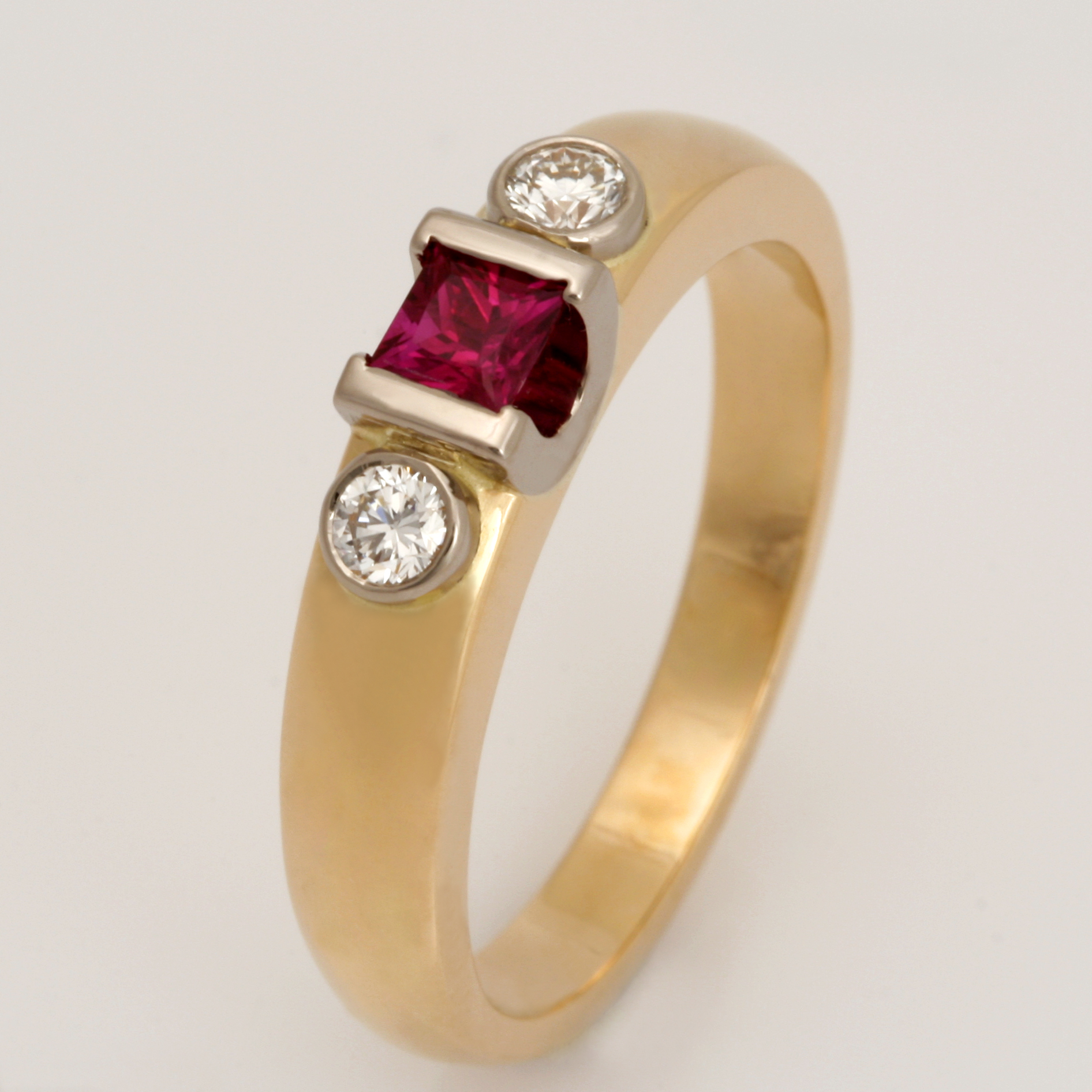 Handmade ladies 18ct yellow gold ring featuring a Burmese ruby and diamonds