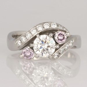 Handmade ladies palladium & platinum diamond engagement ring featuring two purple pink diamonds.