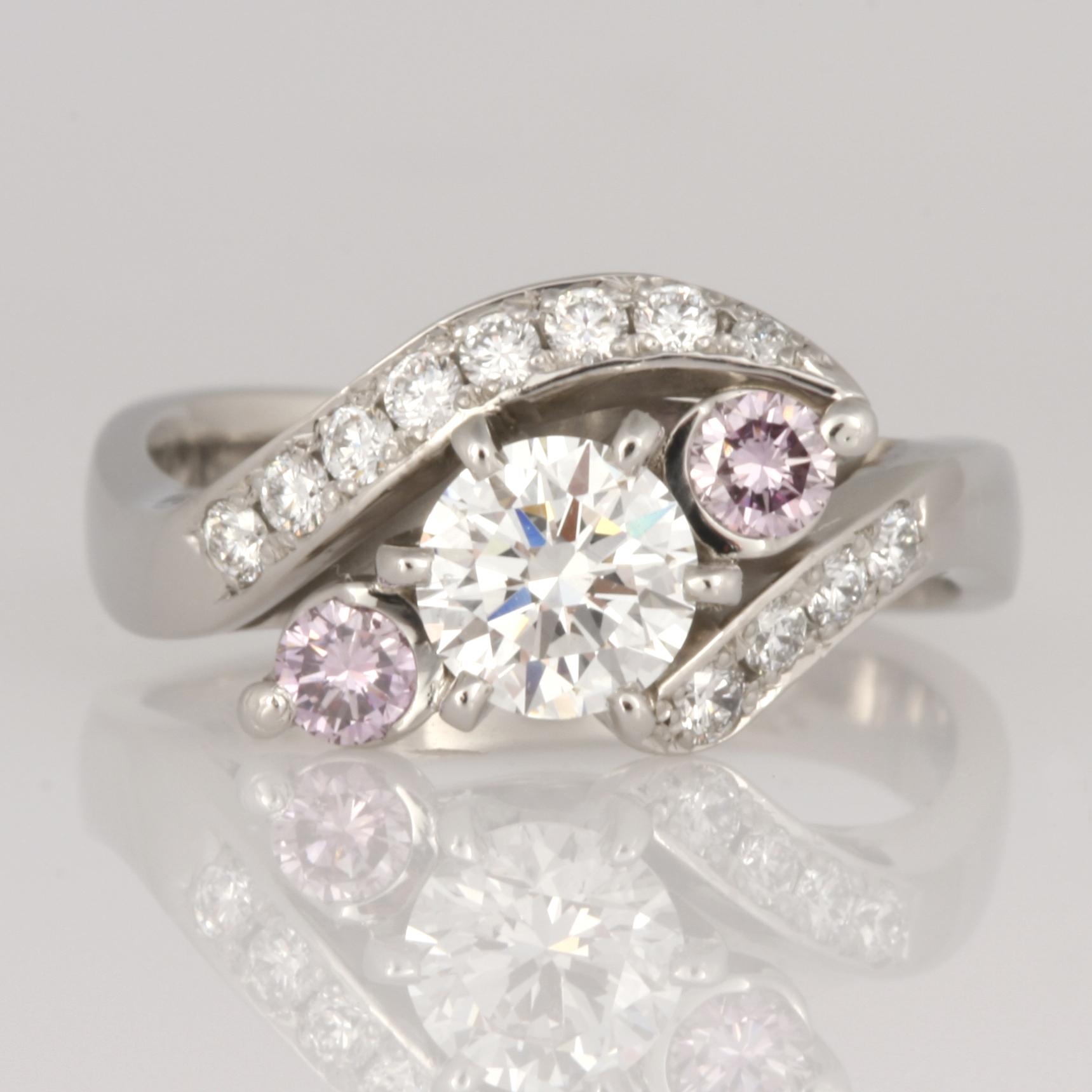 Handmade ladies palladium & platinum diamond engagement ring featuring two purple pink diamonds.