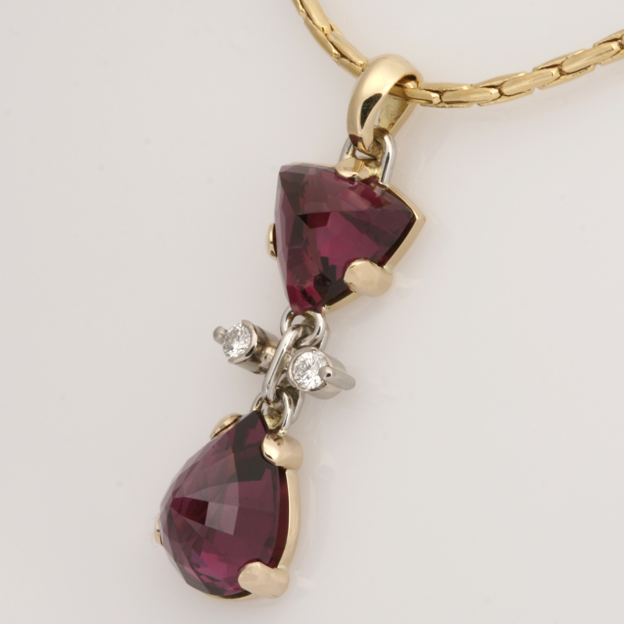 Handmade ladies 18ct yellow gold and platinum pendant featuring rhodolite garnets and diamonds