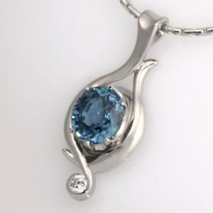 Handmade ladies palladium pendant featuring a Blue Zircon and Diamond.