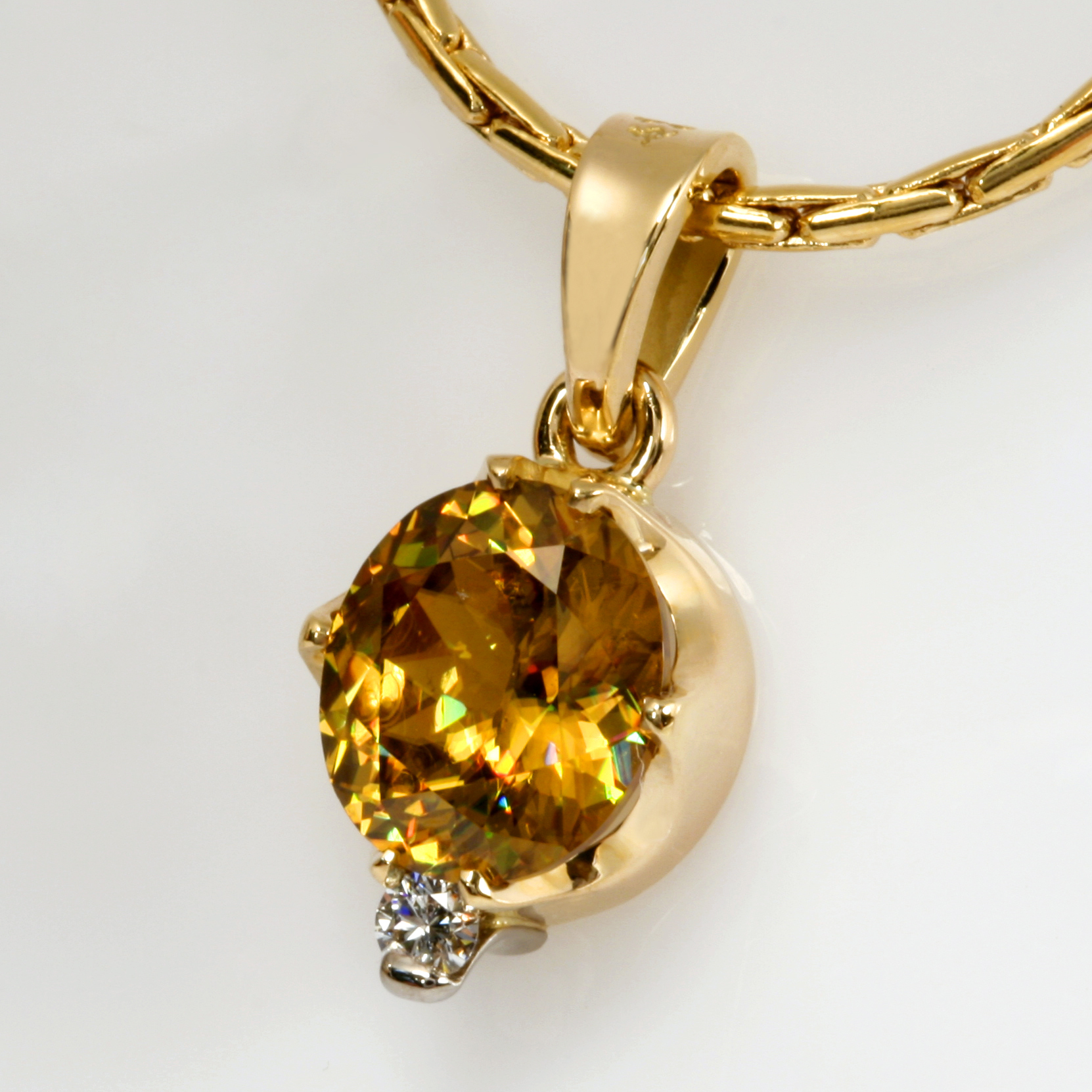 Handmade ladies 18ct yellow gold pendant featuring a Sphene and Diamond.