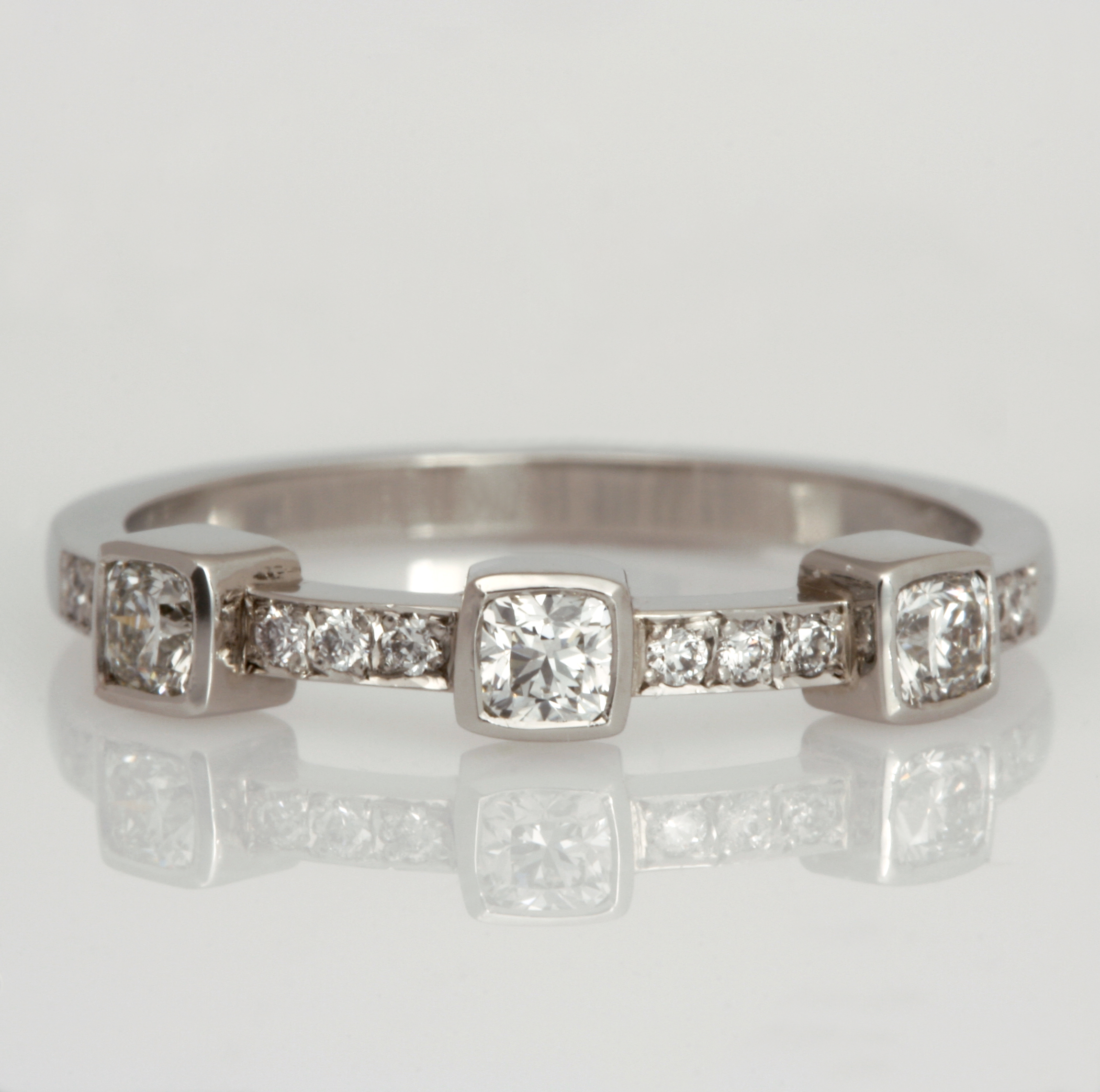 Handmade platinum and diamond ladies wedding ring featuring cushion diamonds