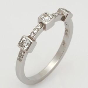 Handmade platinum and diamond ladies wedding ring featuring cushion diamonds