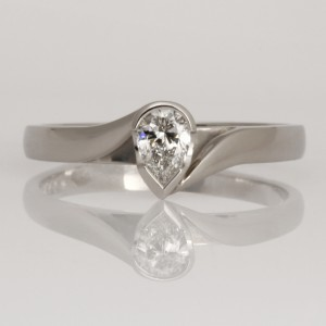 Handmade palladium ring set with pear shaped diamond