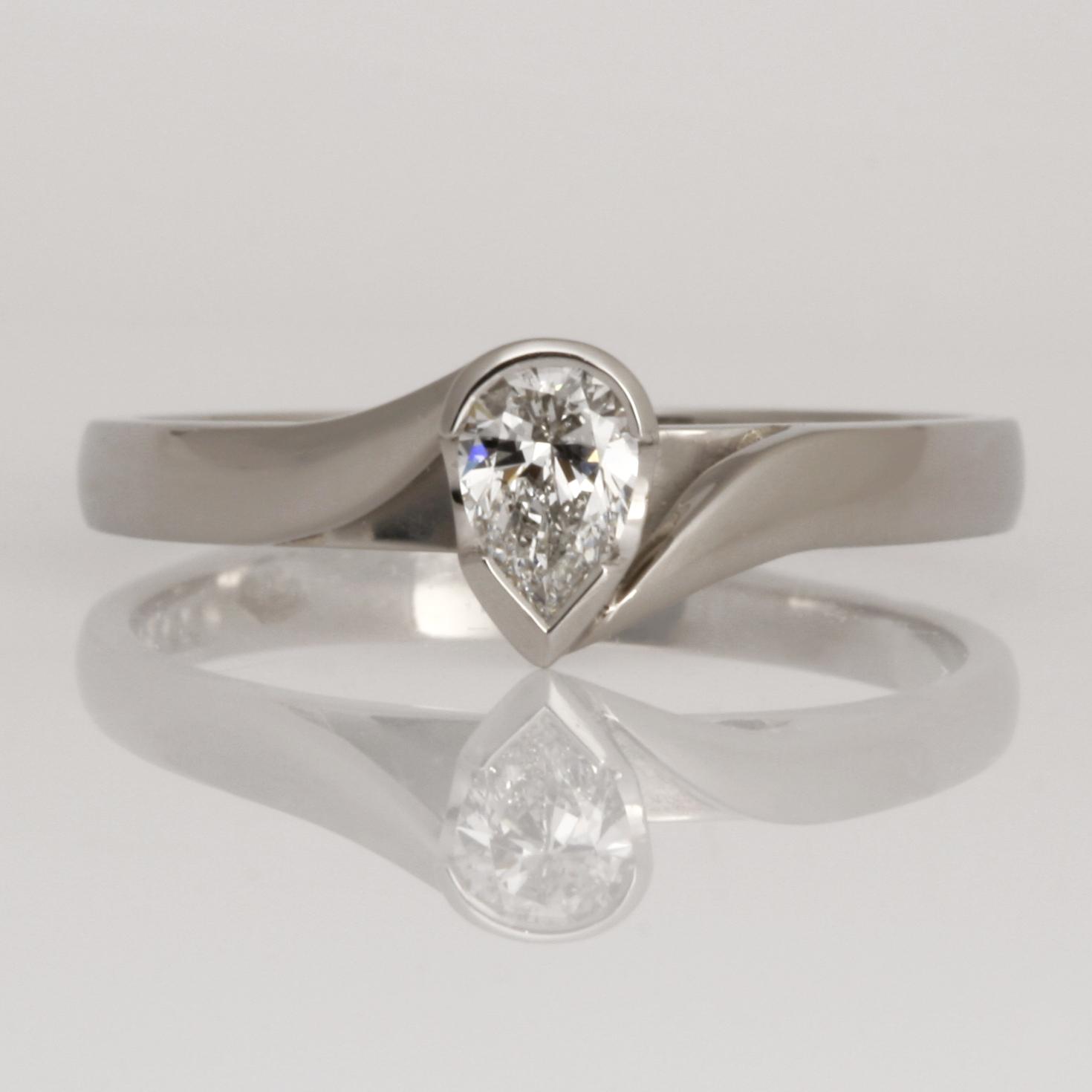 Handmade palladium ring set with pear shaped diamond