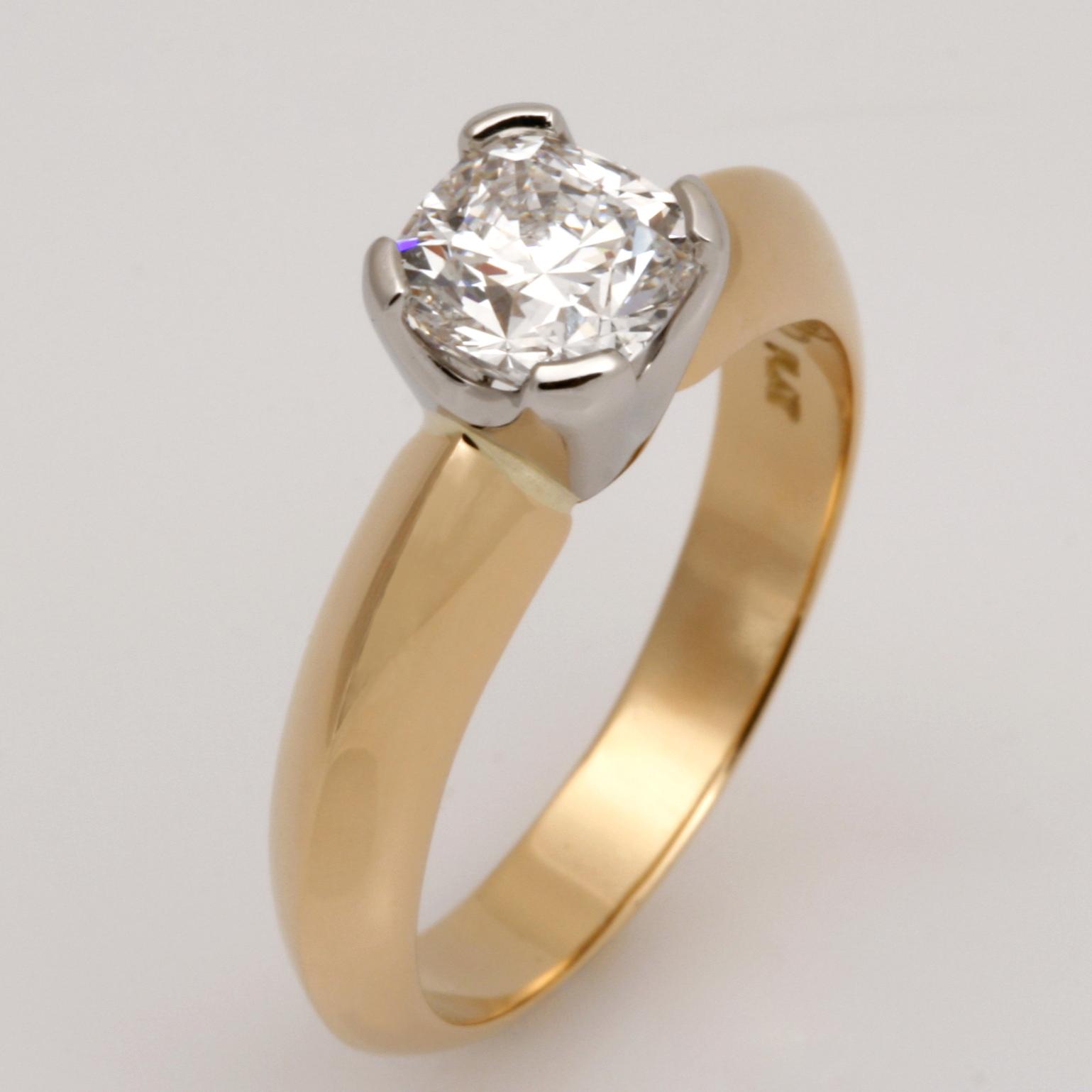 Handmade 18ct yellow gold ring featuring a cushion cut diamond