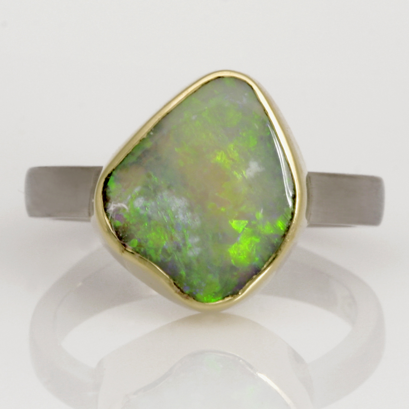 Handmade ladies palladium and 18ct green gold opal engagement ring