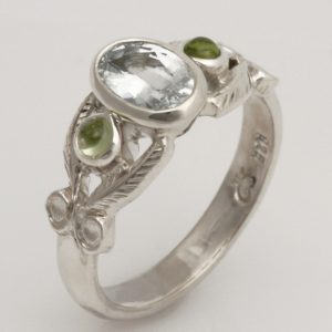 Handmade ladies sterling silver (containing palladium alloy), white Sapphire and Peridot ring